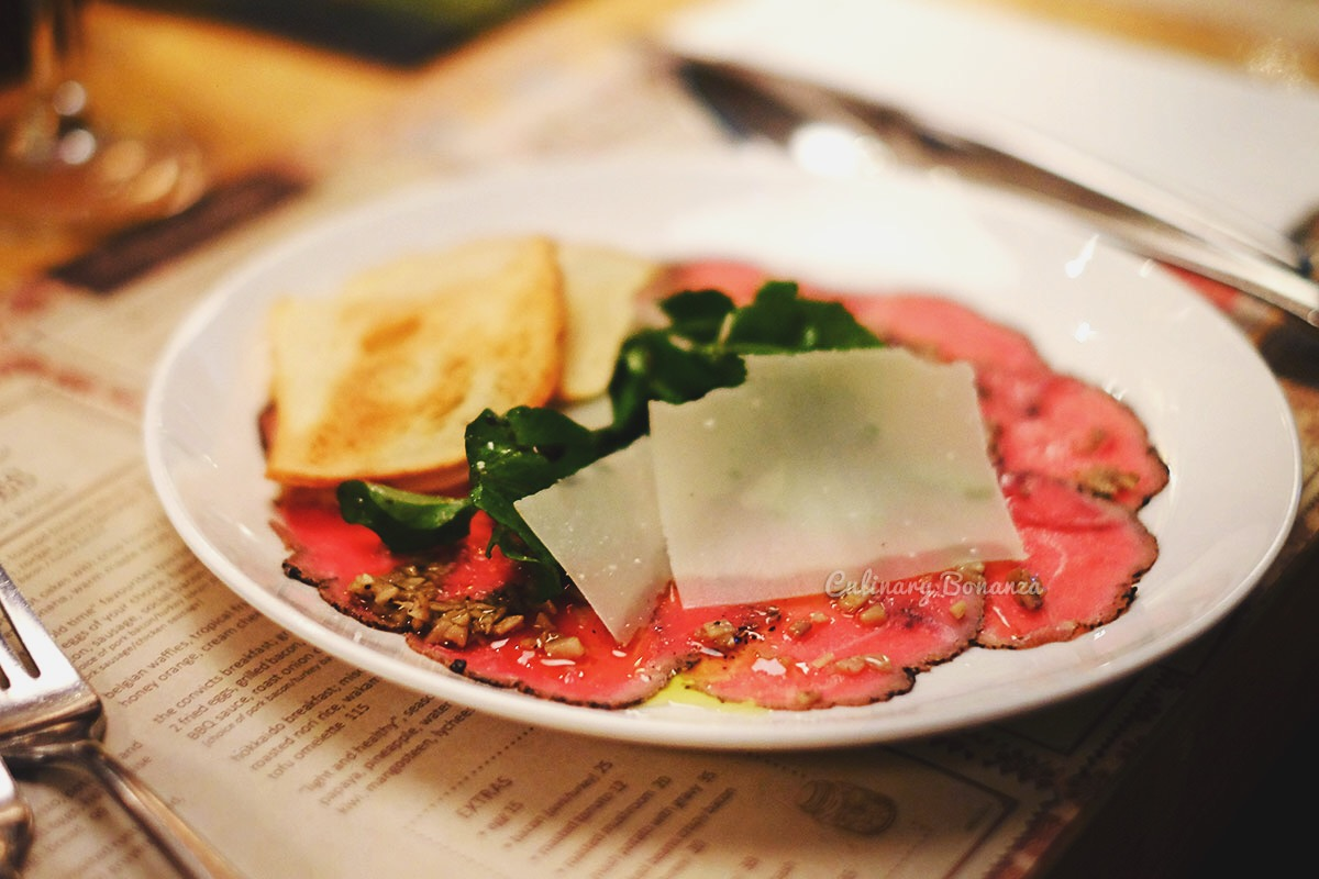 Beef Carpaccio, truffle vinaigrette, wild rocket, parmesan cheese (www.culinarybonanza.com)