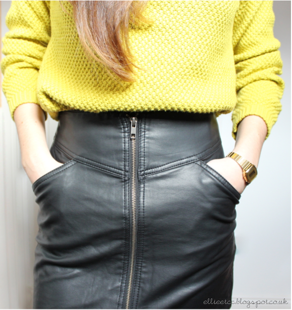 leather_skirt_bright_neon_yellow_jumper_close_up