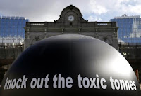 "The words ""Knock out the toxic tonnes"" are seen on a giant ball during a protest by environmental activists in front of the European Parliament in Brussels, Feb. 23, 2015. (Credit: Reuters/Francois Lenoir) Click to Enlarge."
