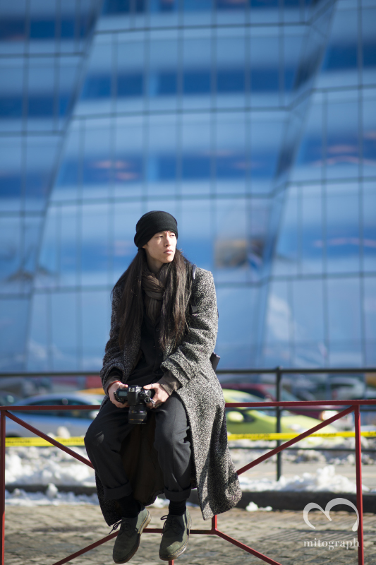 Street Style photographer Wataru Bob Shimosato waits models at the outside of Pier59 during New York Fashion Week