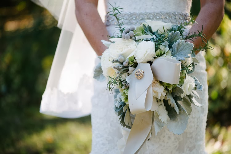 detail photograph of natural bouquet and antique broach