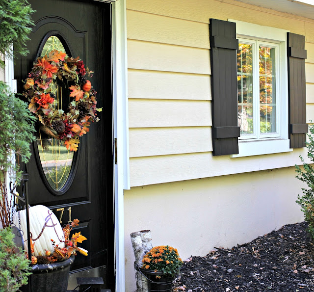Fall outdoor ideas with monogrammed pumpkin and black front door-www.goldenboysandme.com