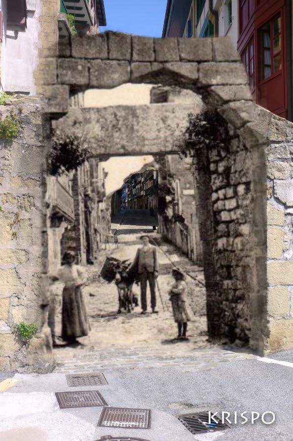 fotografia compuesta de imagen antigua y actual de la puerta de san nicolas de hondarribia