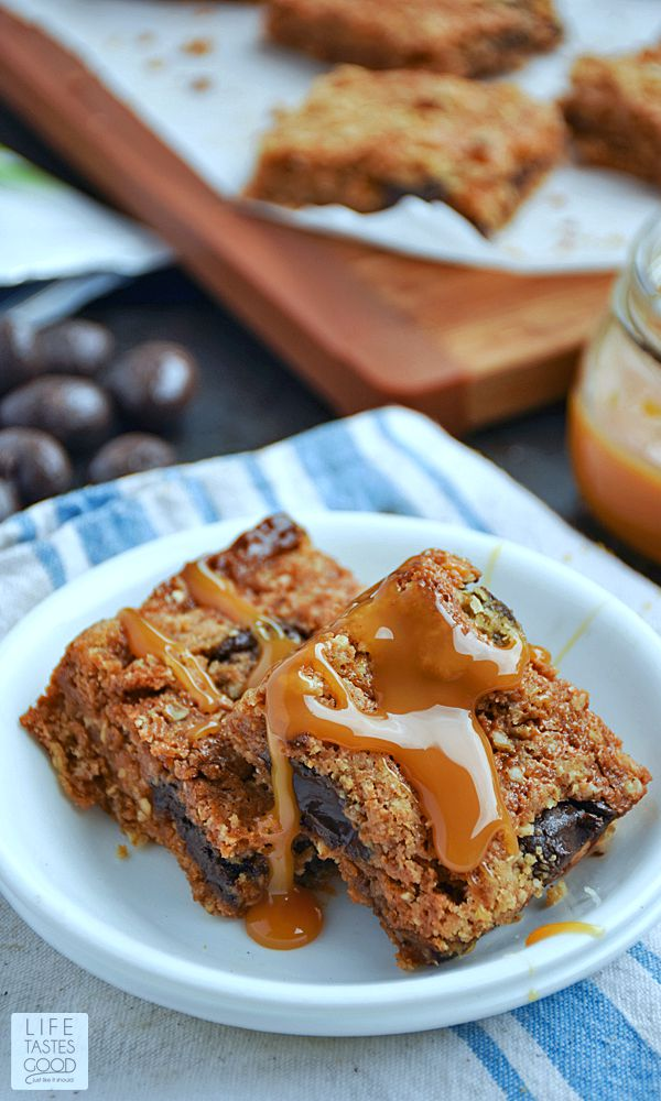 Homemade Chocolate Caramel Bars | by Life Tastes Good have a buttery, brown sugar and oats crust that tastes like the best oatmeal cookie in the entire world, topped with luscious dark chocolate and whole roasted almonds in a creamy caramel sauce under a crumbly streusel topping. Take a moment to savor that thought...