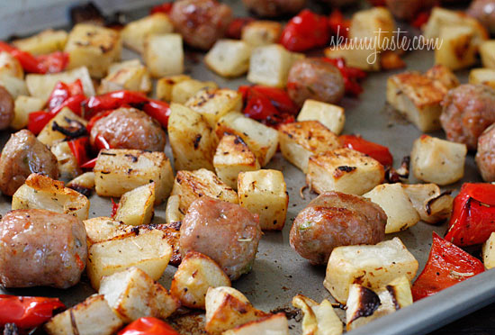 roasted potatoes onions sausage and peppers roast in the oven with a ...