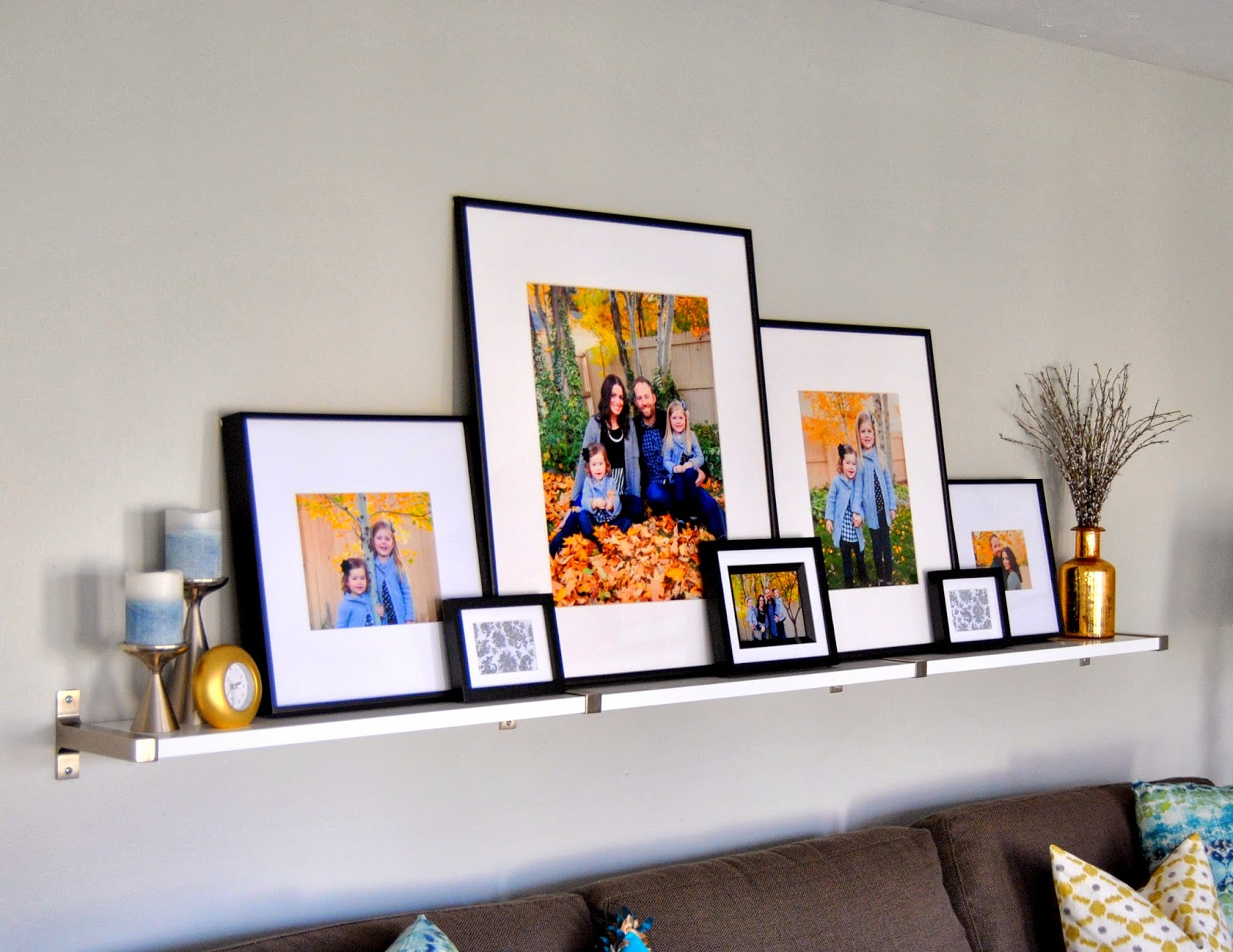 turquoise, gray paint, white shelf, black and white, gallery wall, silver and gold