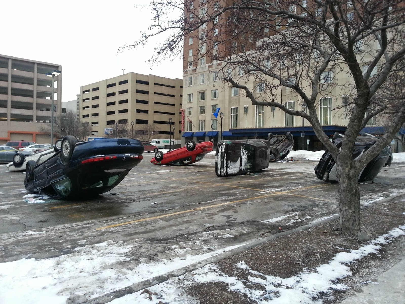 What the heck is going on? - Umm… Why Are All the Cars in the Parking Lot On Their Side?