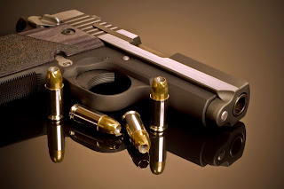Guns with hollow point bullets.