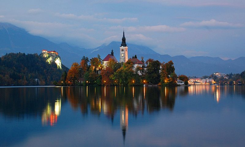 It's twilight on Lake Bled's only island - the Church of the Assumption rises in the center. Photo: WikiMedia.org.