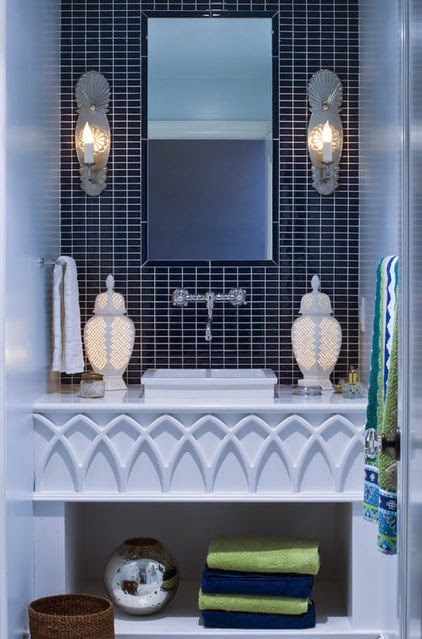 traditionally designed and decorated navy blue and white master bathroom