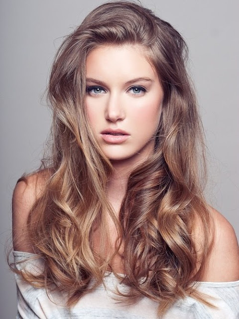 Curly and silky blonde hair style for women