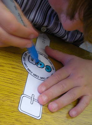 students use Sharpie markers to decorate laminated Time for Sight Words Watches