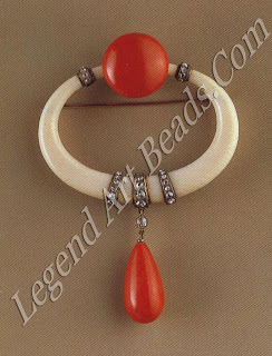 Ivory and coral fibula brooch (c. 1923)