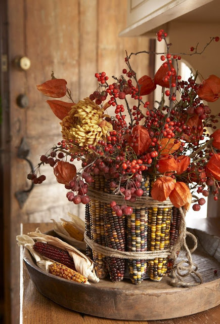This Indian corn and fall flower centerpiece from Karin Lidbeck-Brent is a stunning fall craft that is too easy to make