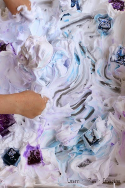 Frozen inspired sensory play with shaving cream and ice.