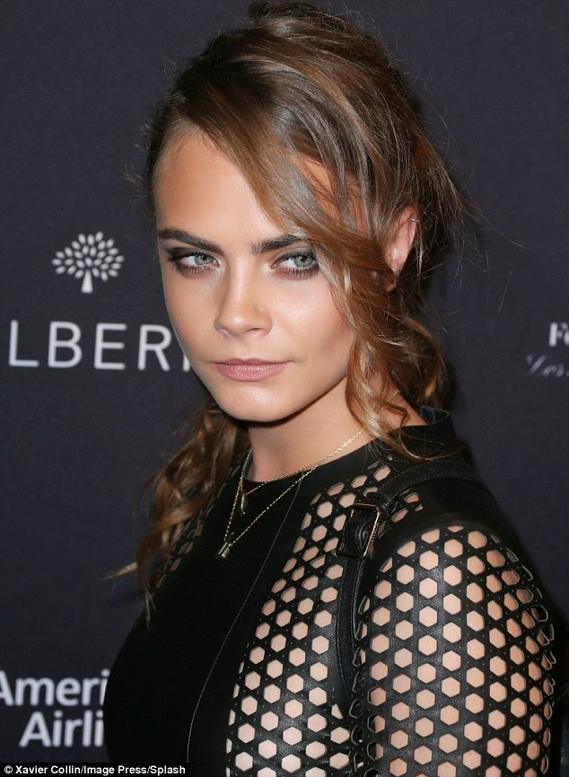 Cara Delevingne in a leather Mulberry dress at the BAFTA LA Tea Party in Beverly Hills