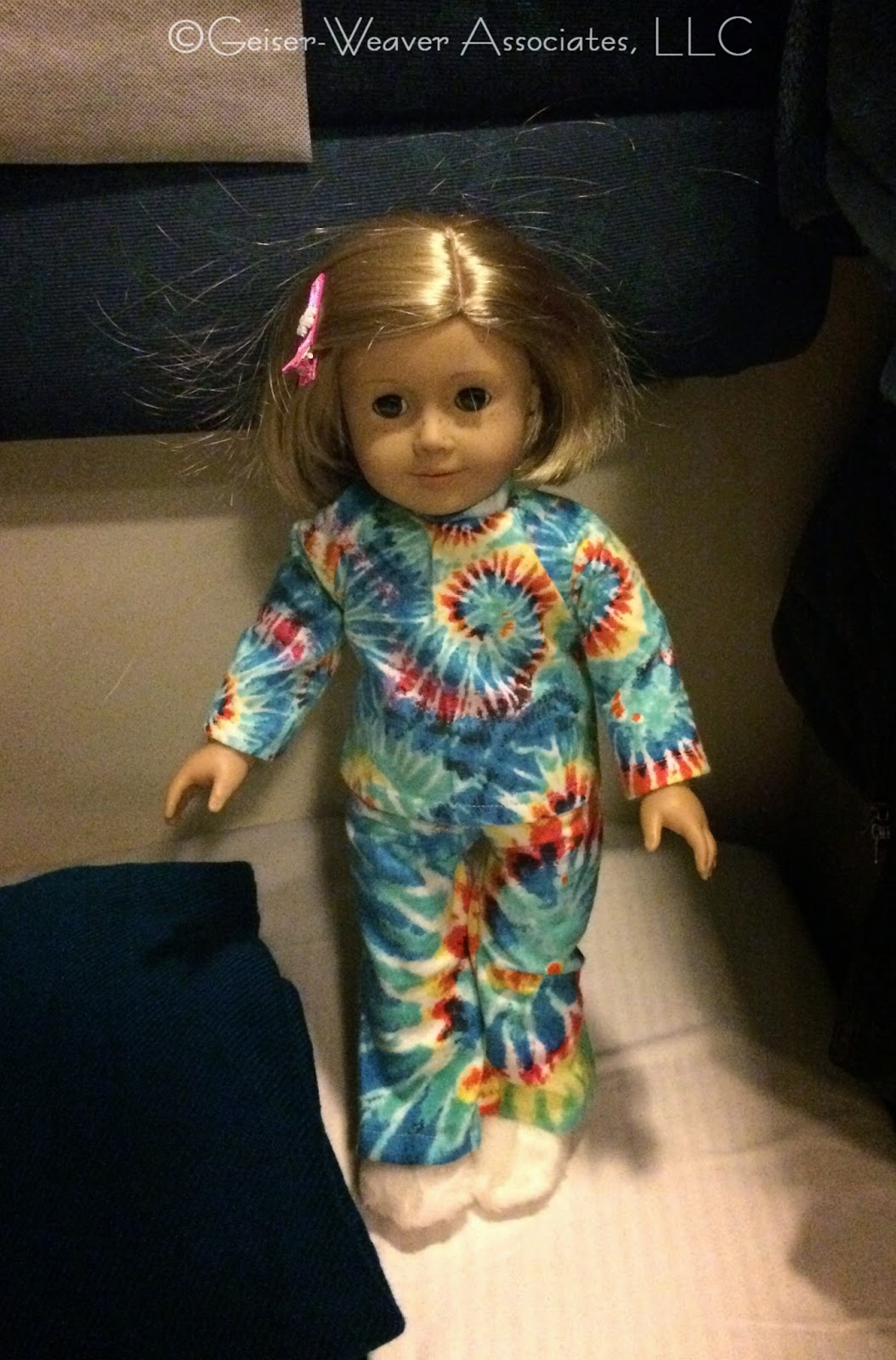 Kit gets ready for bed in the sleeper car on the train- outfit by Geiser-Weaver Associates, LLC