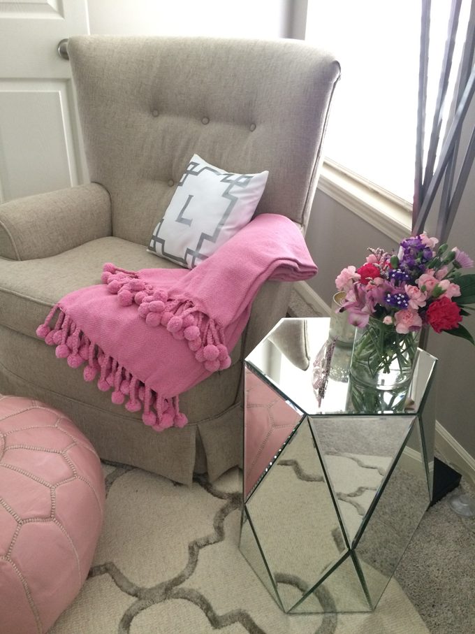glider-chair-pink-throw-pompoms