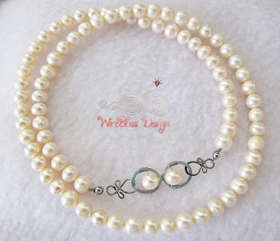 Pearl Necklace with wire wrap infinity clasp by Wirebliss