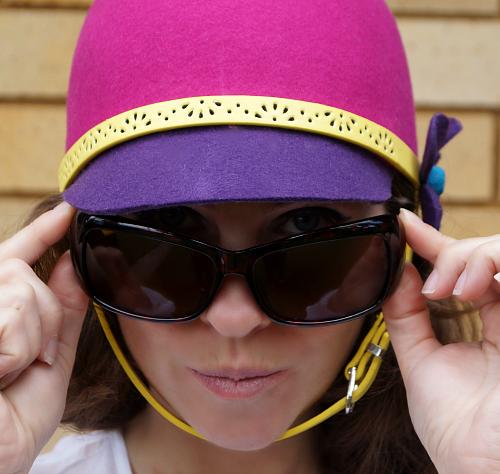 Audrey Hepburn pose in 1960s style helmet hat