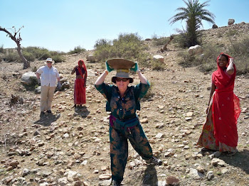 INDIA 2011: DWC Participant carrying  work materials on her head