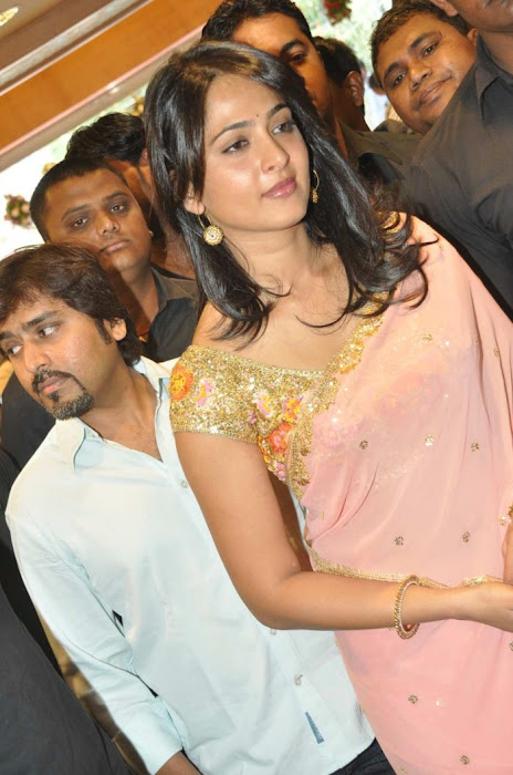 Anushka Shetty in Mustard Saree and Golden Blouse in a Shopping mall photo gallery