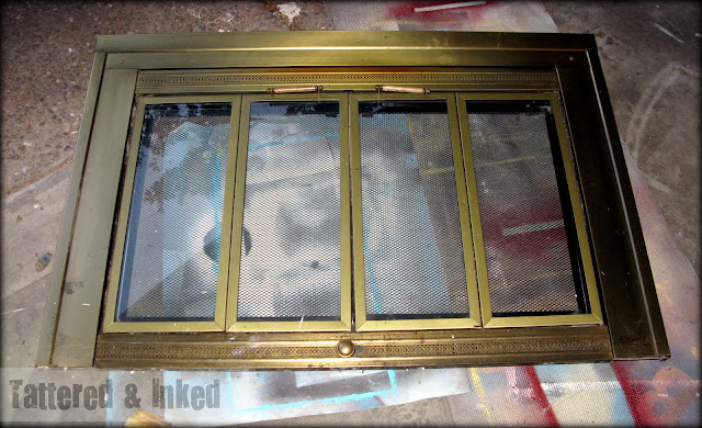 Tattered and inked updating your fireplace without for Silver fireplace doors