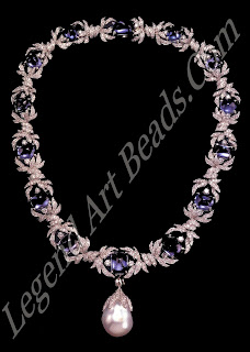 A necklace of cabochon sapphires diamonds, suspending a large baroque pearl