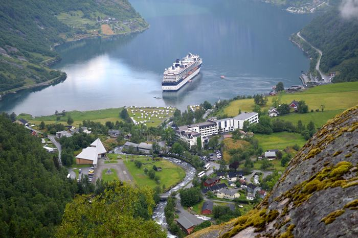 The Geirangerfjorden is a fjord in the Sunnmøre region of Møre og Romsdal county, Norway. It located entirely in Stranda Municipality. It is a 15-kilometre (9.3 mi) long branch off of the Sunnylvsfjorden, which is a branch off of the Storfjorden (Great Fjord). The small village of Geiranger is located at the end of the fjord where the Geirangelva river empties into it.