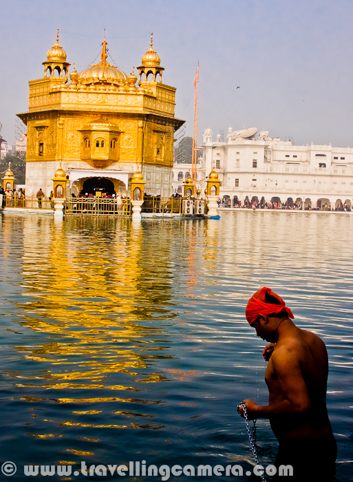 Here is a boy in conversation with God to discuss the plans to make this year memorable for good things in life. Here is taking holy bath in Sarovar around Golden Temple of Amritsar.Golden Temple at Amritsar was over-crowded on 1st Jan 2012, as many folks from Punjab has come to this place for good beginning of the year and pray God for making 2012 a memorable year for good things in life. Amritsar being a very old city of India looks very scary during such special days, when whole Punjab is on street and there is hardly any space around. This was my third visit to  Amritsar and now probably I will  think twice to visit this city again. It's not tourist friendly and extremely inconvenient. But reaching at Golden Temple make you forget everything you see outside it.A Very Happy New Year to all of you again !!!