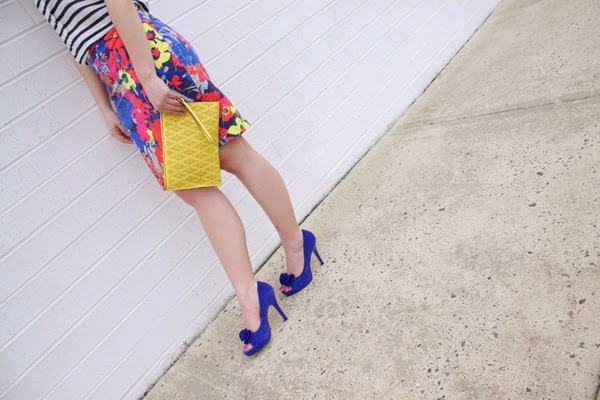 Striped top, floral skirt, blue heels, yellow Aldo clutch