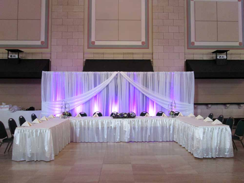 The Room Had A Lovely Purple Glow Thanks To Our LED Uplights They Lit Up Fabric Backdrops Focusing Attention On Head Table And Cake