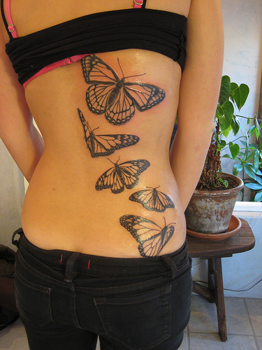 quote tattoos on ribs for girls. Tattoos Girls On Ribs - Flower