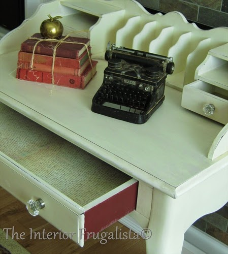 French Provincial desk makeover with drawers painted in Sangria chalkpaint, lined with vintage script paper, and clear glass knobs.