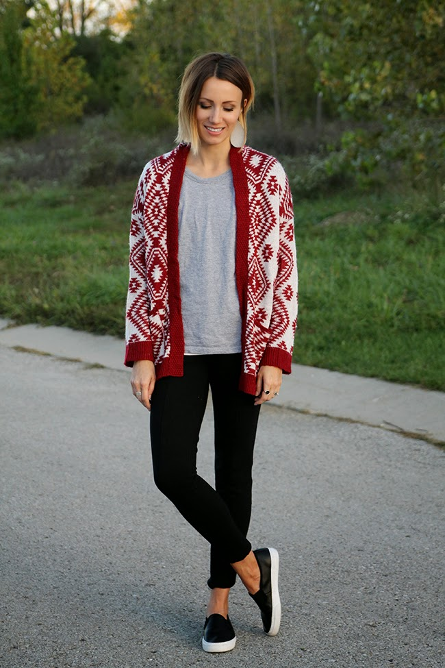 Red Aztec sweater, gray tee, black pants