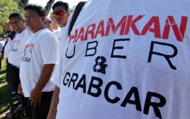 SPAD disaman 102 pemandu teksi kerana isu Uber dan Grabcar