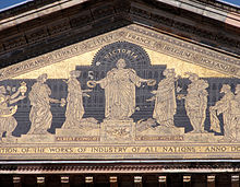 Frieze detail from internal courtyard Victoria and Albert Museum showing Queen Victoria in front of the 1851 Great Exhibition.