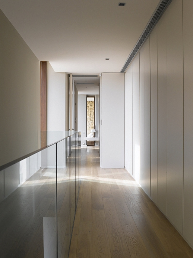 Minimalist hallway with glassy railing