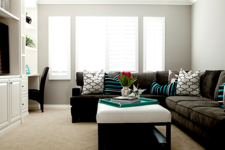 Turquoise Wall with Dark Brown Sofa