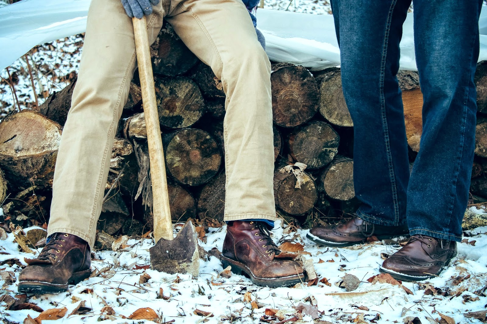 are we out of the woods yet snow georgia outdoors winter photography ax axe leather boots shoes wood brown jeans khaki pants friends models men