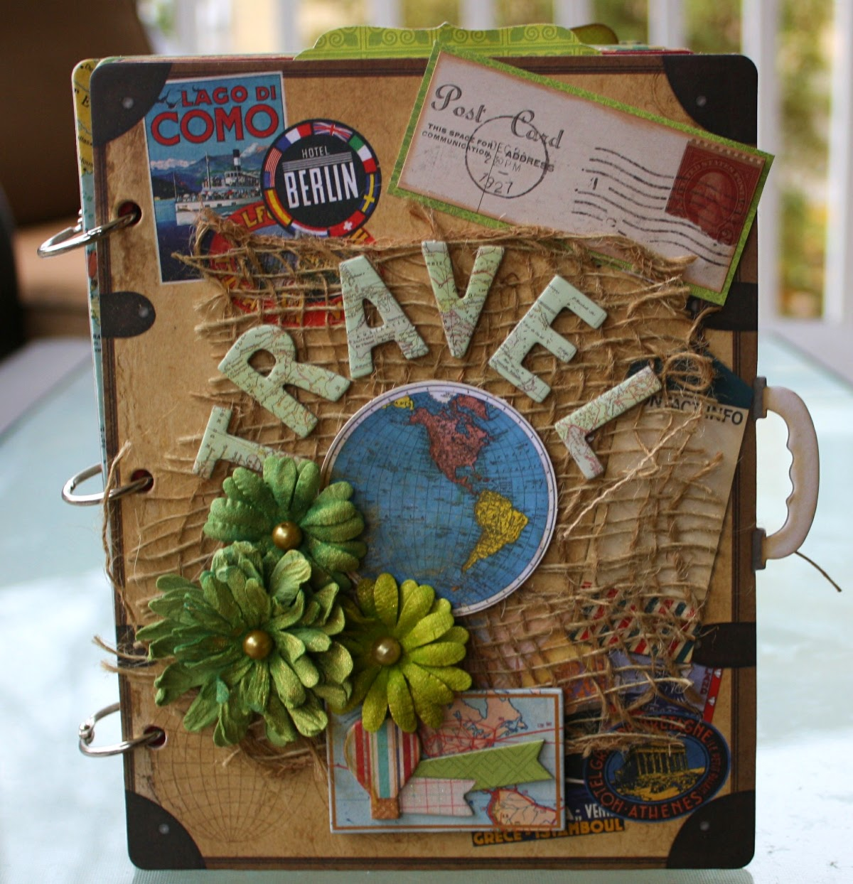 Travel albumn by Gabrielle Pollacco using Bo Bunny chipboard album, papers, chipboard accents, stickers and Noteworthy die cuts from the Souvenir collection as well as Bo Bunny Blooms and Glimmer Mist
