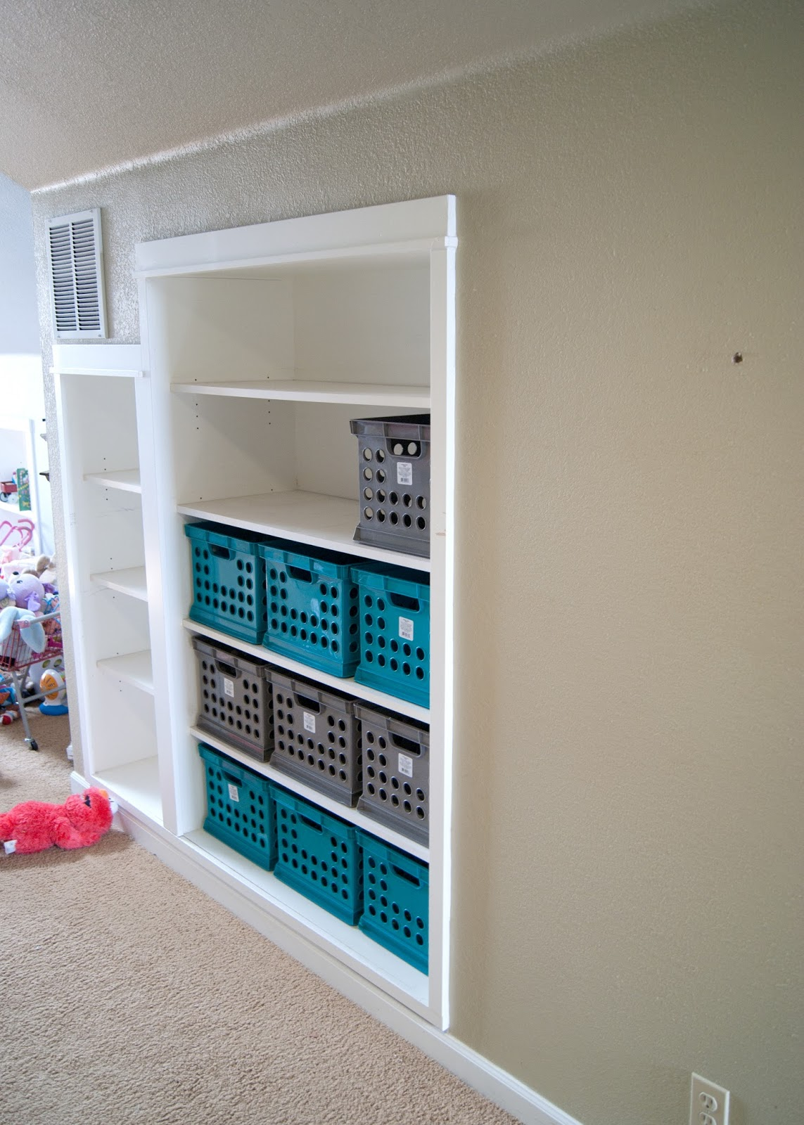 Built in shelves part way full of milk crates