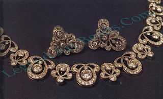 A platinum diamond-set necklace and earrings designed by P1111 and made at A. Tillander around 1950