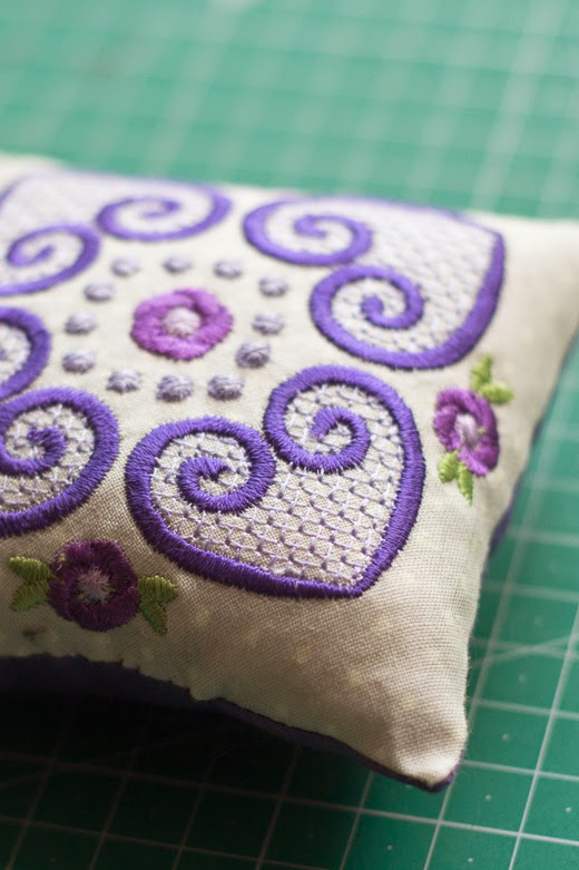 Purple embroidery on pincushion