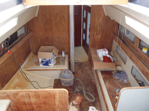 sanding the interior of a boat