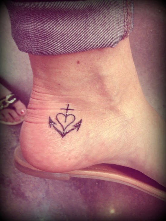 Heart and anchor tattoo on feet