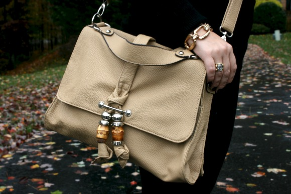 Baige purse, black leggings, gold link bracelet