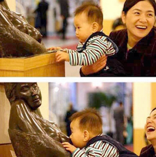 funny picture: Chinese baby breastfeeding