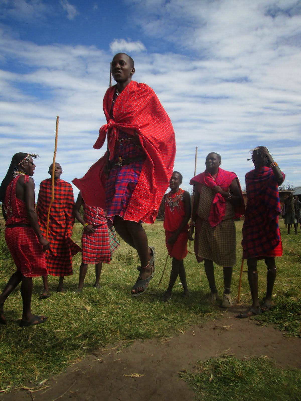 "Leaping Masai warriors doing the ""Lion Dance,"" Ewangan Masai Cultural Village"