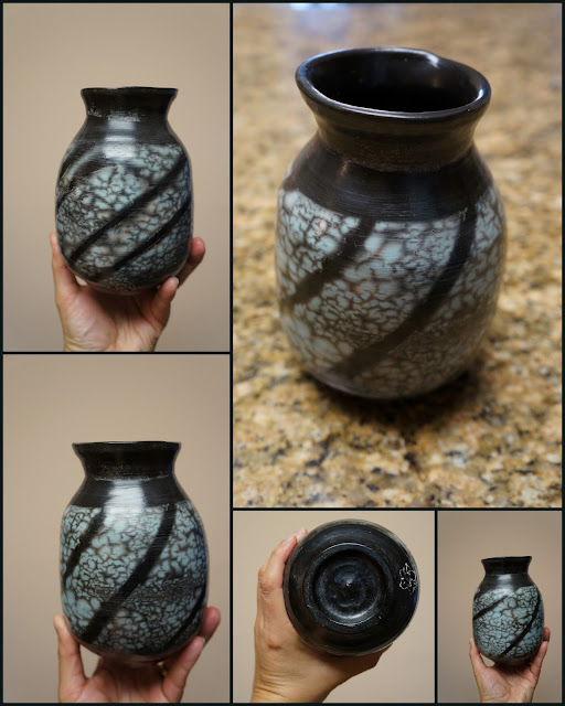 Naked raku pottery - nice result, a turquoise vase with black stripe pattern.